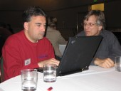 photo of two men working with a laptop